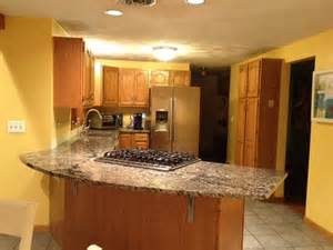 yellow walls with oak cabinets not loving this color combo counter is similar to s