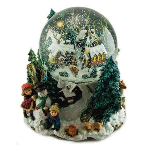winter scene snow globes snow globes carillon musical ornaments