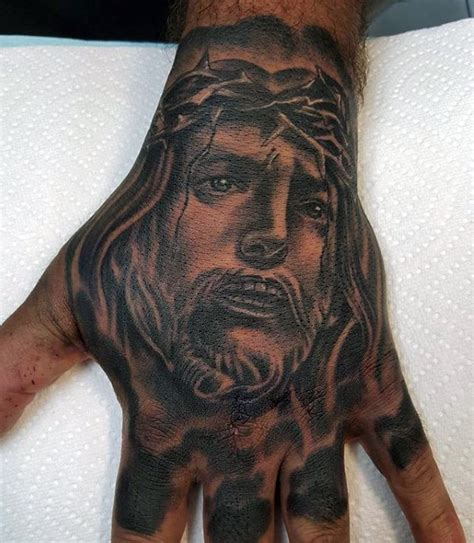 tattoo hand jesus 20 jesus hand tattoo designs for men christ ink ideas