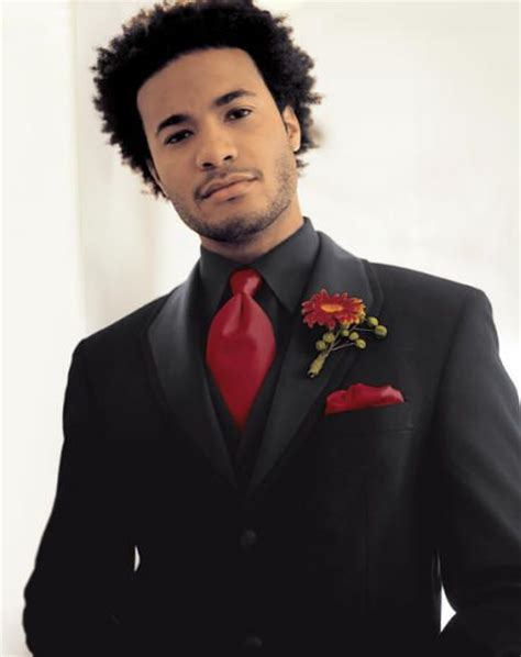 black suit red shirt with vest groom don t like the flower but i do like the black