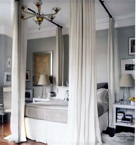 bed with curtains around it add elegance with canopy beds