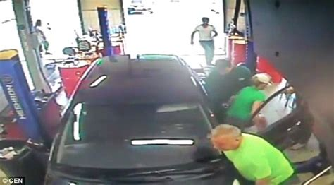 Garage Workers by Confused Driver Hits The Accelerator And Runs