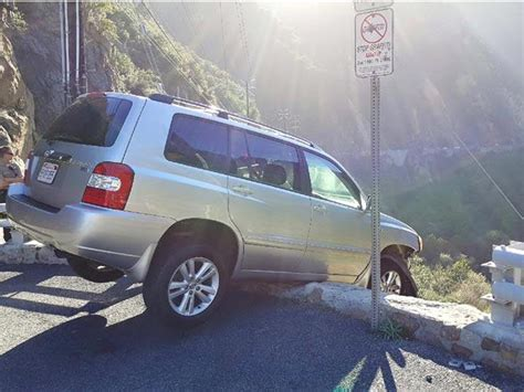 hill sheriff department escapes car stuck on precipice only to be struck by
