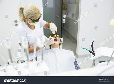 the diode laser in dental hygiene dentist using modern diode dental laser stock photo 492298165