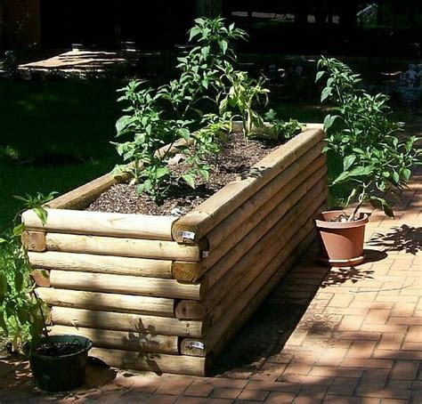 log raised bed diy raised garden landscape timbers