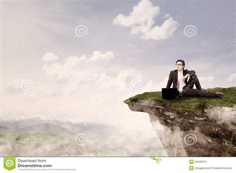 businessman sit  top  mountain royalty  stock