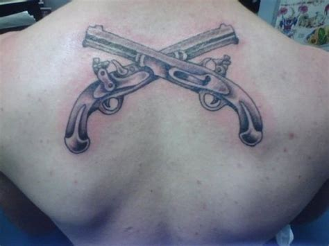 crossed revolvers tattoo crossed pistols picture at