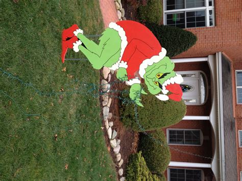 grinch stealing christmas lights yard art decoration by