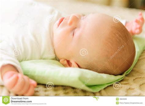 baby sleeping in bed cute newborn baby sleeping in bed royalty free stock image image 28843006