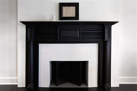 black fireplace mantel transitional living room