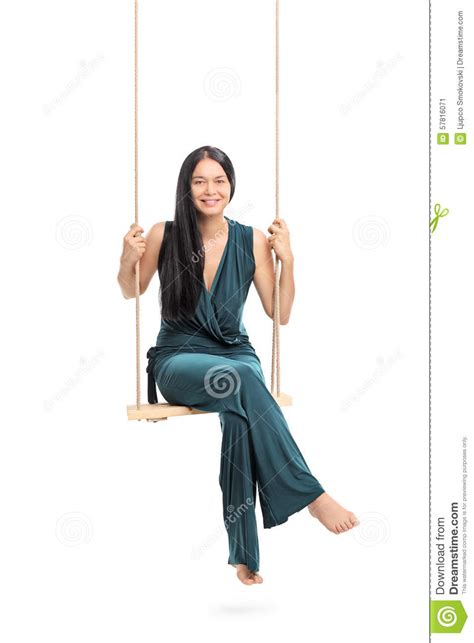 sitting on a swing fashionable woman sitting on a swing stock photo image