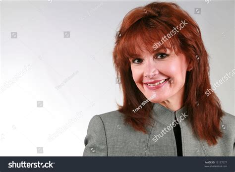 older women with red hair beautiful mature business woman red hair stock photo