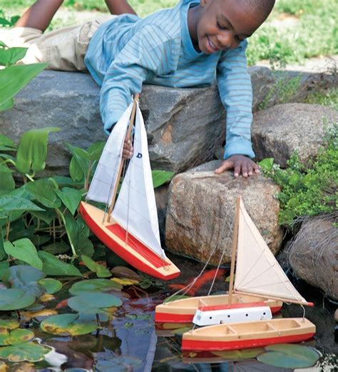 float boat wood spruce wood toy boats sailboat catamaran and sloop