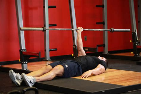 Floor Pres by One Arm Floor Press Exercise Guide And