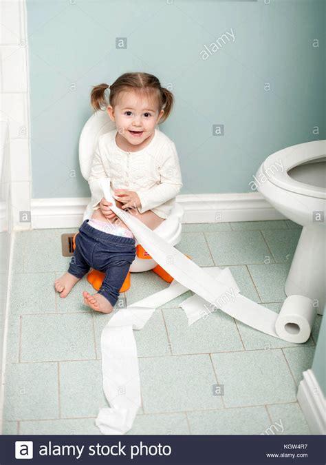 girl on toilet potty training sitting toilet toilet training white stock photos