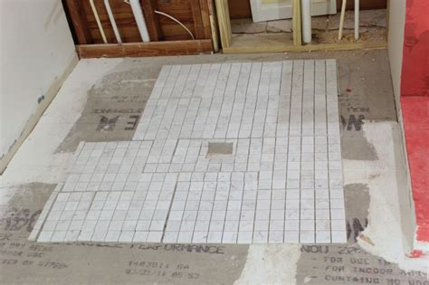 tiling a bathroom shower with marble tile