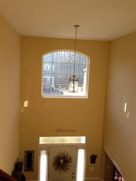 Foyer Windows need help with second story arched foyer window