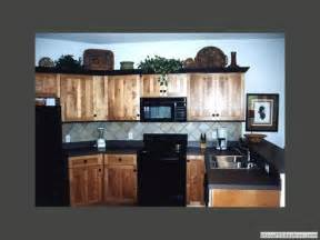 example of hickory with black black counter top and grey backsplash home kitchen pinterest