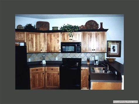 Backsplash In The Kitchen example of hickory with black black counter top and grey