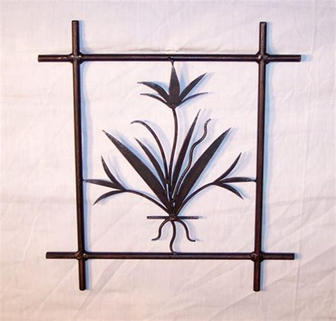 ornamental metal wall decor wrought iron wall decor with candles the reflection of
