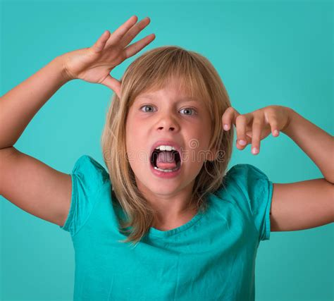 angry little girl in pink isolated on a white background angry little girl growls isolated on turquoise background