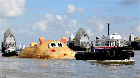 Thames Barrier Festival | huge wooden hippo is towed up river thames ahead of