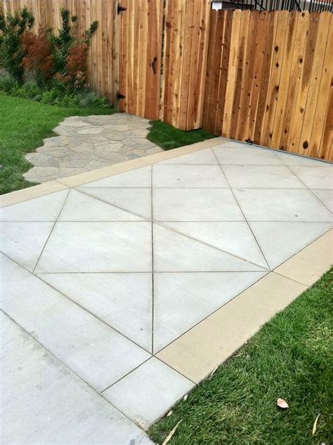 diamond cut concrete driveway with color band and mega