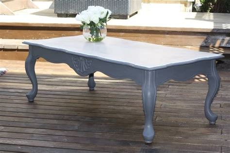 sold provincial coffee table refinished in grey chalk paint with a stained white top