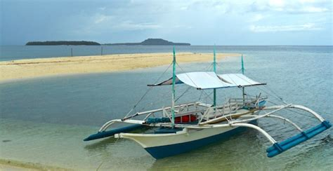 small fishing boat in the philippines travel tuesday sunsets and beaches of the philippines
