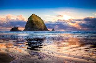 haystack rock photograph by niels nielsen