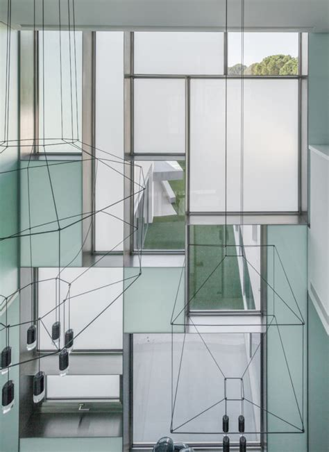 Sliding Glass Doors Open Both Sides A Madrid House Looks Like A Geometric Sculpture Design Milk