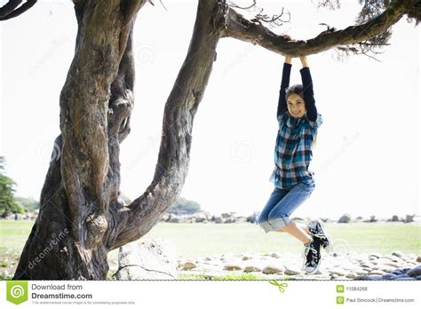 swinging from a tree tween girl swinging from tree branch royalty free stock