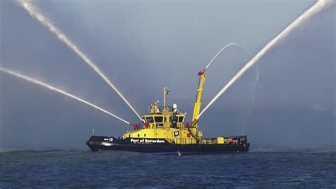 tugboat water salute seaport rotterdam 3 march 2015 fireboat rpa 12 performs