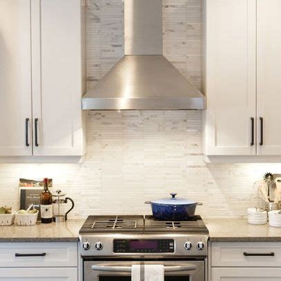 should you tile under kitchen cabinets white cabinets with tile marble backsplash stainless