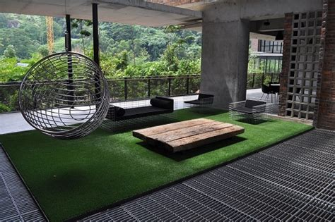 outdoor grass rug a green space with an artificial grass rug