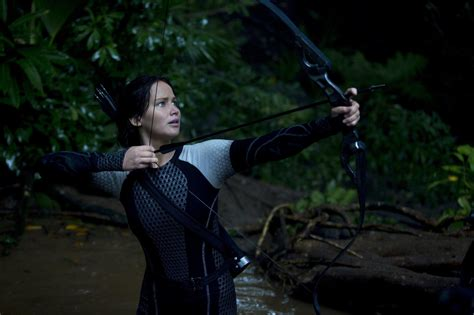 biography of hunger games movie catching fire passes iron man 3 domestically as top