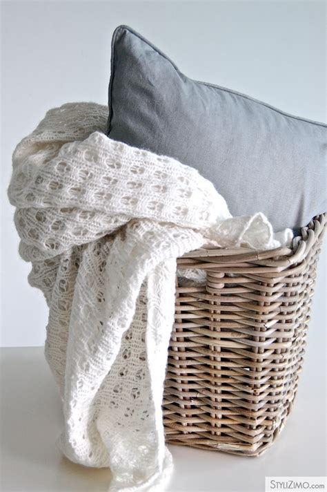 large basket for storing throw pillows wire basket near the fireplace for blankets and pillows