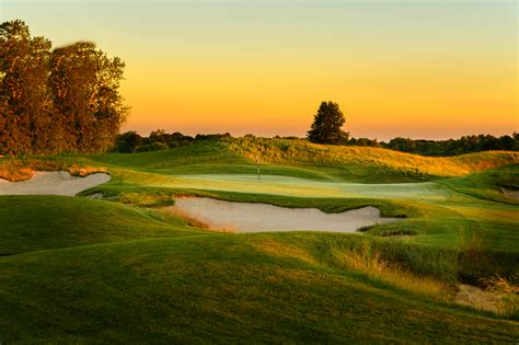 sunset course at country club golf course deep bunkers purgatory golf club