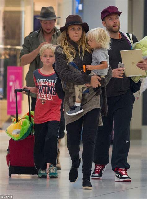 teresa palmer family pics teresa palmer clutches son bodhi with husband mark webber