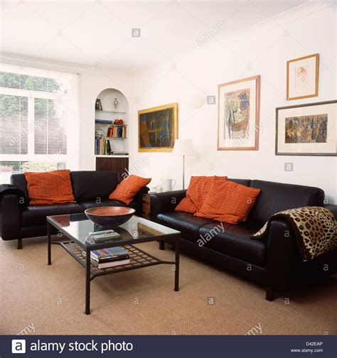 Orange Cushions On Black Leather Sofas In Living Room With Black Leather Sofa In Living Room