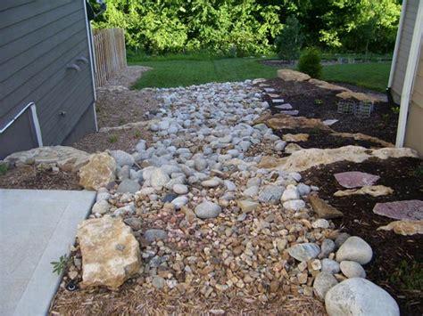 backyard water drainage solutions landscape vest exteriors