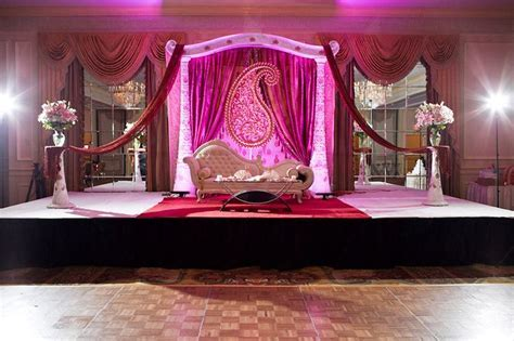 pink/purple and white indian wedding stage, with deeply