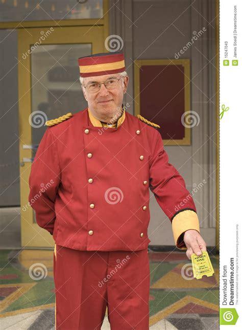 cineplex uniform usher with movie ticket stock photos image 15247043