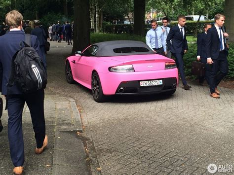 pink aston martin guy turns up at in pink aston martin vantage