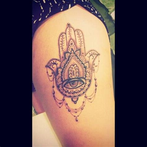 hamsa side thigh tattoo brings good luck and wards off