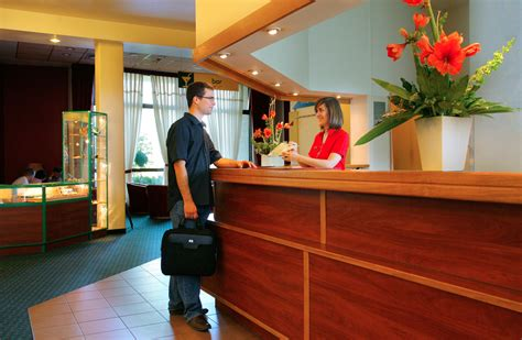 At The Front Desk by Hotel Front Desk The Peer
