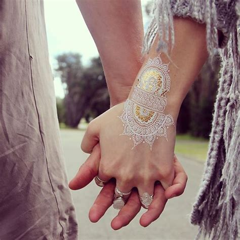 stunning white henna inspired tattoos