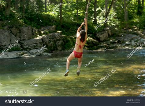 rope swing over water girl on rope swing over river stock photo 1570956