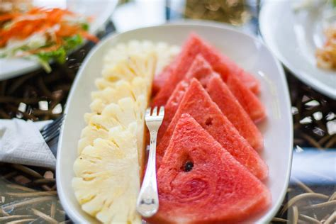 Pineapple Watermelon Detox by Sliced Watermelon And Pineapple Fruit With Stainless Steel