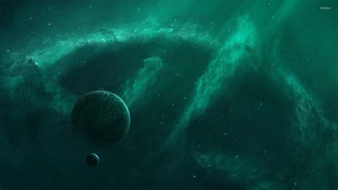 wallpaper space green green nebula surrounding the planet wallpaper space